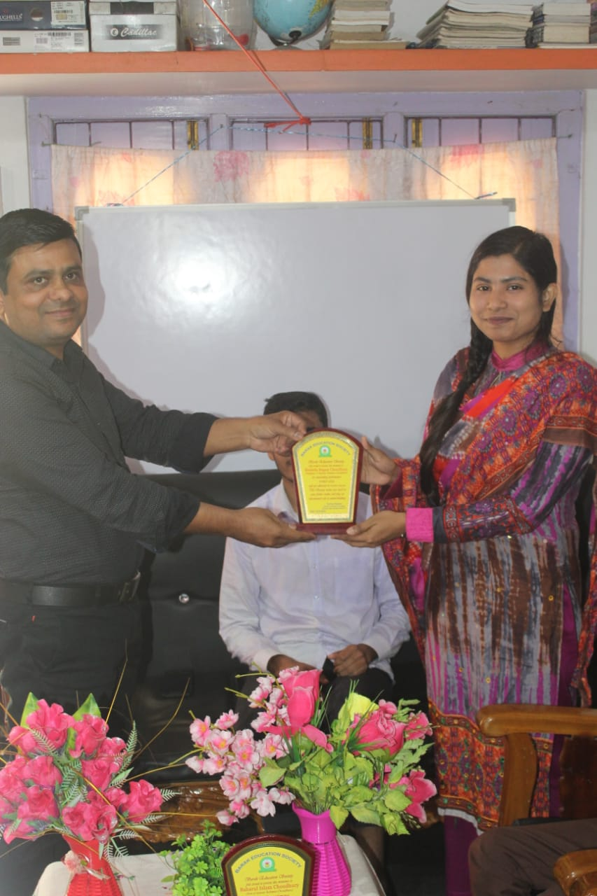 Karimganj District Coordinator, felicitating a NEET, 2020 qualified lady student
